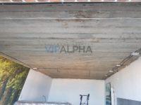 Монтаж натяжного потолка в гостиной